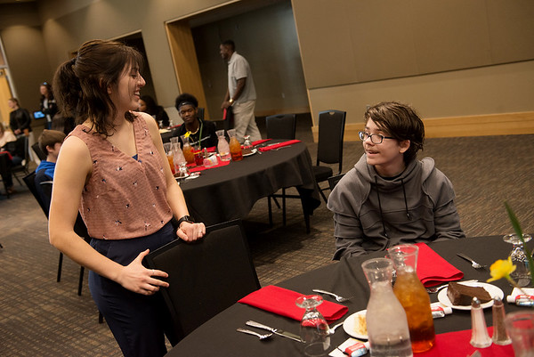 Madison Monsour, Pittsburg State fourth year student, talks with Brent Dawson, a sophomore at Parsons High School, during an etiquette course at Pittsburg State on Wednesday.<br /> Globe | Roger Nomer