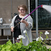 Masey Coates, Joplin High sophomore, waters plants during Monday's Joplin FFA plant sale at Franklin Tech.<br /> Globe | Roger Nomer