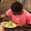 Jervel Weathersby, Pittsburg High freshman, eats during an etiquette lunch at Pittsburg State on Wednesday.<br /> Globe | Roger Nomer