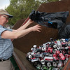 Tony Wright, Carthage, recycles cans at the Joplin Recycling Center on Wednesday.<br /> Globe | Roger Nomer
