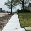 A new sidewalk is finished along Joplin Street on Tuesday.<br /> Globe | Roger Nomer