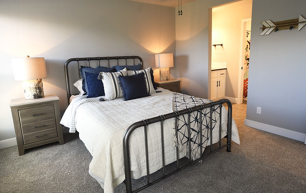 One of four bedrooms is pictured in the 2,600-sq ft. St. Jude's Dream Home, which will be raffled on May 22. Tours of the $275,000 home will be offered from April 13 to May 19. The house also features three bathrooms.<br /> Globe | Laurie Sisk