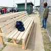 AT&T volunteers take a lunch break near one of two new dugout benches during restorations on Tuesday at the field. The field is the last free-use ball field in Joplin and AT&T employees welcome members of the community to help restore the field on Saturday. From the left: Andy Robeson, Cynthis Williams, Roxanne Isley and April Arnall.<br /> Globe | Laurie Sisk