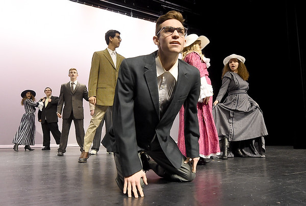 """Del Stanley, center, portrays a townsperson as he joins the cast during rehearsal for the Joplin High School production of  """"Hello Dolly!"""" on Wednesday at JHS. Stanley also portrays the character Stanley in the popular musical.<br /> Globe 