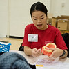 Sou Viengluang, Wichita, talks about dental health on Friday during the Kansas Mission of Mercy free dental clinic at Pittsburg State University.<br /> Globe | Roger Nomer