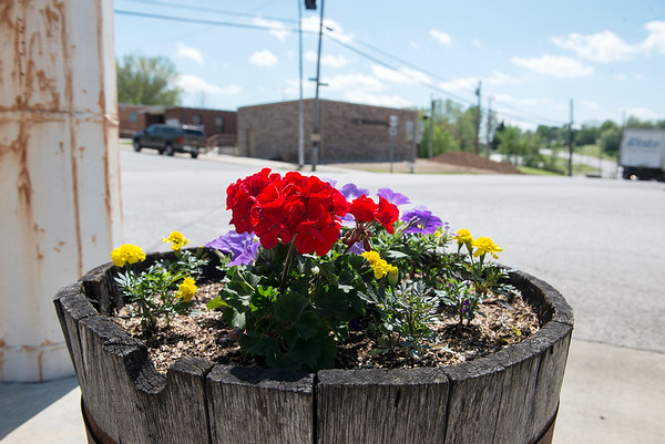 Granby citizens have adopted planters in the downtown area and decorated them with flowers.<br /> Globe   Roger Nomer
