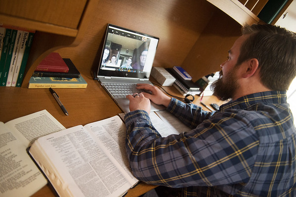 Jordan Bence, pastor of The Vine Lutheran Church, leads a Bible study from his home in Joplin over Zoom on Wednesday evening. Bence has taken to teleconferencing to keep in touch with his church members.<br /> Globe | Roger Nomer