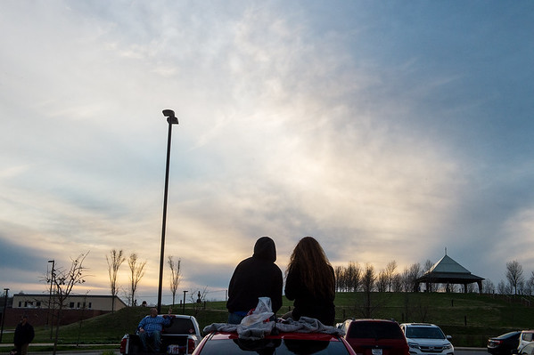 Asia Huffman and Austin Hendrix listen to worship music from their car during an outdoor event at Mercy Park on Wednesday.<br /> Globe   Roger Nomer