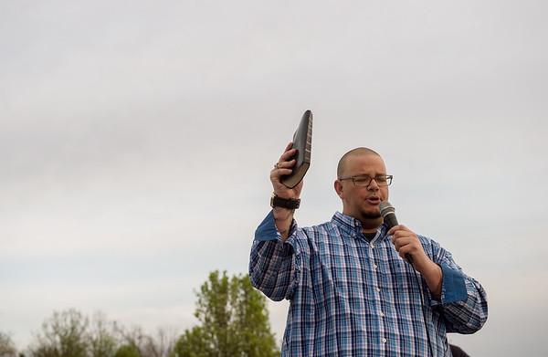 David DuRall opens an outdoor worship event with prayer at Mercy Park on Wednesday evening.<br /> Globe   Roger Nomer