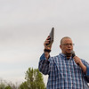 David DuRall opens an outdoor worship event with prayer at Mercy Park on Wednesday evening.<br /> Globe | Roger Nomer