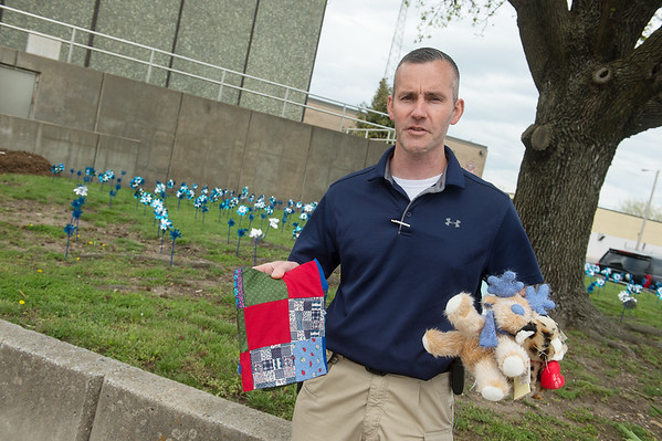 Wes Massey, Joplin police detective, talks about items that are given to comfort victims of child abuse during an interview on Thursday at the Joplin Police Department.<br /> Globe | Roger Nomer