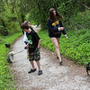 (from left) Eleven-year old twins Sam and Mary, and thirteen-year old Charlie walk their dogs along the Ruby Jack Trail in Carthage on Thursday.<br /> Globe | Roger Nomer