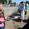 Globe/T. Rob Brown<br /> Mara Knight, left, a PSU student, practices on a pink guitar given to her by her grandfather, while she waits near the end of a long line at Landreth Park Wednesday morning, Aug. 22, 2012. Knight and many others auditioned for their chance at American Idol.