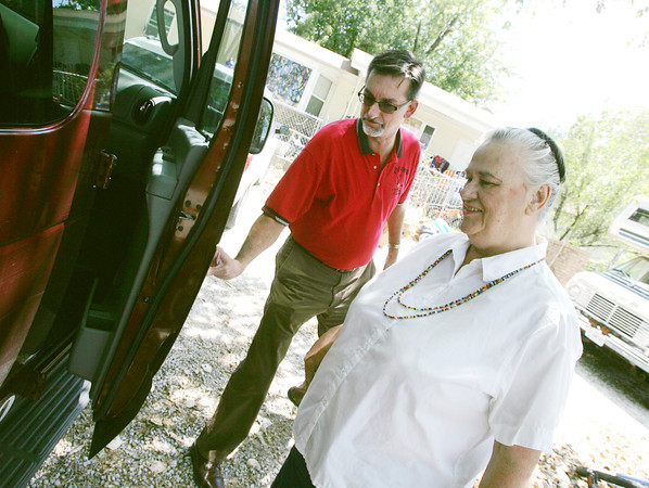 Globe/Roger Nomer<br /> Gary Stubblefield, president of the Carl Junction Chamber of Commerce, opens the door for Joyce Burwick as he drives her to the senior center on Tuesday.
