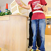 Globe/T. Rob Brown<br /> Jake Mitchell throws a bean bag while balancing during a physical therapy session Wednesday afternoon, Aug. 1, 2012, at the Ozark Neuro Rehab Center in Springfield.
