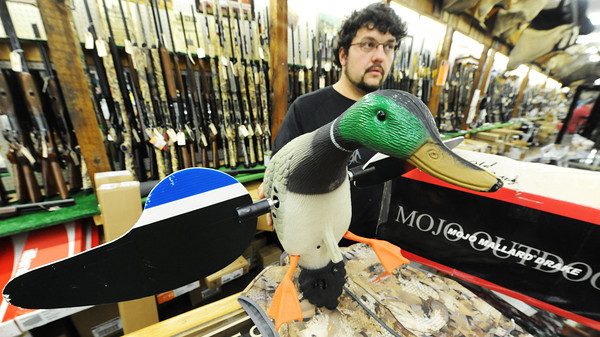 Globe/T. Rob Brown<br /> Salesman Clark Fritton shows the Mojo Mallard Drake, a motorized decoy, by Mojo Outdoors, to a customer Friday afternoon, Aug. 31, 2012, at John's Sport Center in Pittsburg, Kan.