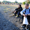 Globe/T. Rob Brown<br /> Brandon Walker, of Webb City, and Bailey Park, of Joplin, take a seat after waiting in a long line to register for an American Idol audition at Landreth Park Wednesday morning, Aug. 22, 2012. The two friends were waiting for a relative to arrive.