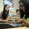 Globe/Roger Nomer<br /> Lauren Newton checks out the games on Rosa Garcia's new iPad.  The Baxter Springs Middle School seventh graders received their new iPads on Monday afternoon.