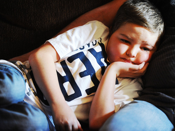 Globe/T. Rob Brown<br /> Ten-year-old Dylan Waggoner, of Webb City, lays on the sofa and leans on his father Tuesday afternoon, Aug. 21, 2012, in his Webb City home. Young Waggoner is in need of a heart transplant.