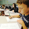 Globe/T. Rob Brown<br /> Carl Junction High School sophomore Paul Lefebvre, right, takes a practice ACT Thursday afternoon, Aug. 30, 2012, during school with classmates (in background, from left) juniors Joseph Nguyen, Caroline Adams and Tasha Steele.