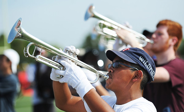 Globe/T. Rob Brown<br /> Sophomore Axel Mendoza plays the trumpet during the Webb City High School Band Camp Thursday morning, Aug. 2, 2012, at the school's field.