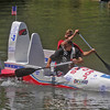 Globe/Roger Nomer<br /> Carl Oberg, top, and Jason Gillow pilot The Spirit of Joplin downstream during the cardboard boat races at the Shoal Creek Water Festival on Saturday.