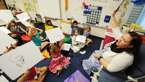 Globe/T. Rob Brown<br /> Ashley Wright, a first-grade teacher at McKinley Elementary School, uses a formative assessment technique to grade students' understanding of numbers and writing during class Wednesday morning, Aug. 29, 2012. The Joplin School District is changing its grading process for students.