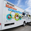 Globe/T. Rob Brown<br /> Corey Lindsey, maintenance and bus driver for the KidCare Connection bus, goes out to the bus to prepare it for Sunday's event on Friday afternoon, Aug. 3, 2012, at the Community Health Center of Southeast Kansas in Pittsburg.