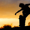Globe/T. Rob Brown<br /> Chris Myers, 12, of Joplin, rides his skateboard at sunset Saturday, Aug. 4, 2012, on the Joplin Skate Park ramp at Schifferdecker Park.