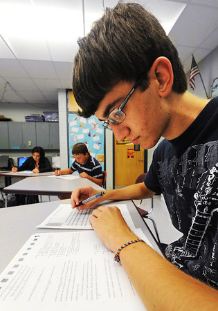 Globe/T. Rob Brown<br /> Carl Junction High School junior Jonathan Eaton takes a practice ACT Thursday afternoon, Aug. 30, 2012, during school.