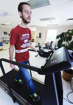 Globe/T. Rob Brown<br /> Jake Mitchell walks on a treadmill during a physical therapy session Wednesday afternoon, Aug. 1, 2012, at the Ozark Neuro Rehab Center in Springfield.