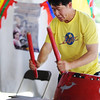 Globe/T. Rob Brown<br /> Phong Nguyen, a parent with the La Salle Youth Group of San Jose, Calif., plays drums to help promote the youth group's stage performance during Marian Days Thursday morning, Aug. 2, 2012, in Carthage.