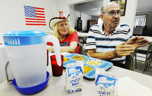 Globe/T. Rob Brown<br /> Thomas Hubbard, right, and his wife, Lucile Hubbard, both of Frontenac, Kan., talk about social security issues, pensions and the future of retirement Tuesday afternoon, Aug. 28, 2012, at the Pittsburg Community Center during a lunch for senior citizens.