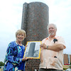 Globe/Roger Nomer<br /> Gwen and Duane Hunt hold a photo of the Barn Theater, all of which remains today is the silo.