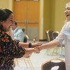 Globe/Roger Nomer<br /> Jeanie Leonard, left, greets Ashley Carter before the Eid al-Fitr celebration at the Holiday Inn Convention Center on Sunday.