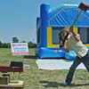 Globe/Roger Nomer<br /> Henry Riley, 9, tests his strength on a carnival game during Cowtown Days in Kiwanis Park in Baxter Springs on Saturday.