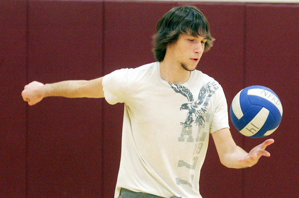Globe/Roger Nomer<br /> Ethan Underwood, 17, serves a ball while playing at the Nevada Community Center on Tuesday afternoon.