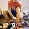 Globe/T. Rob Brown<br /> Hunter VanLue, of Webb City, tries on a pair of tennis shoes at Champ's Sporting Goods in Northpark Mall recently.