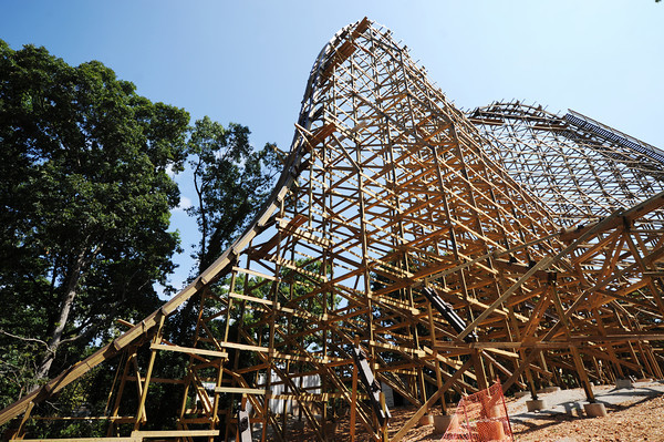 Globe/T. Rob Brown<br /> A view of the steep drop, from below, of the Outlaw Run wood rollercoaster Thursday morning, Aug. 9, 2012, at Silver Dollar City. The new coaster is being touted as the first wood coaster to feature a double barrel roll in addition to its record-breaking 81-degree steep drop and a projected top speed of 68 miles per hour.