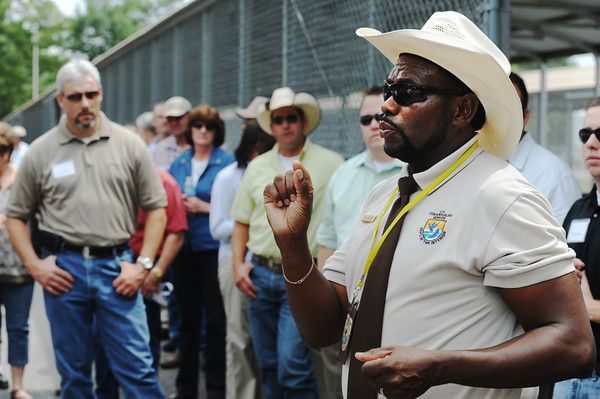 Globe/T. Rob Brown<br /> David Hendrix, Neosho National Fish Hatchery manager, explains the growth stages of the rainbow trout Friday afternoon, Aug. 24, 2012, at the hatchery during Congressman Billy Long's agriculture and industry tour in Southwest Missouri.