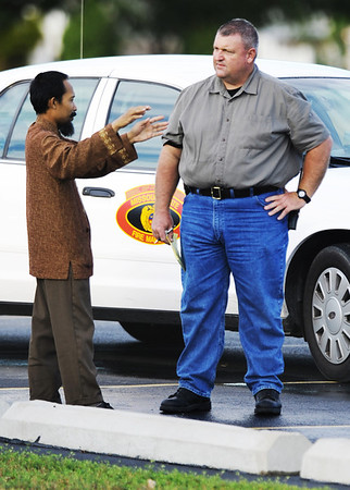 Globe/T. Rob Brown<br /> Imam Lahmuddin, left, speaks with an investigator outside the Islamic Society of Joplin mosque Monday morning, Aug. 6, 2012.