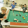 Globe/Roger Nomer<br /> (from left) Clay Clayton, 5, Dakota McCartney, 9, and Eli Griffiths, 7, play a game of pool at the Nevada Community Center on Tuesday afternoon.