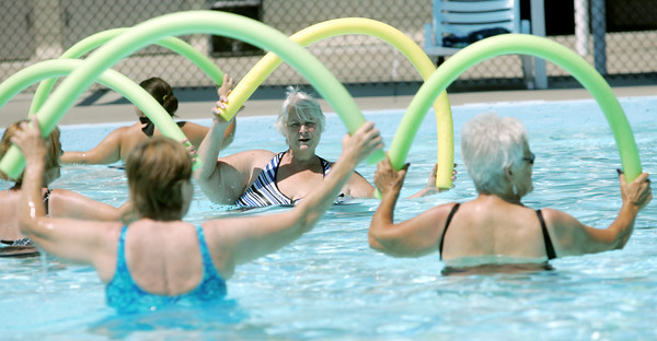 Globe/Roger Nomer<br /> Virginia Watts does a water exercise at Walton Park pool on Tuesday afternoon.