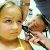 Globe/T. Rob Brown<br /> Five-year-old patient Ava Edwards, of Pittsburg, Kan., doesn't quite know what to think about her first examination by Dr. Krista Mijares, pediatrician, Friday afternoon, Aug. 3, 2012, at the Community Health Center of Southeast Kansas in Pittsburg.