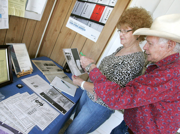 Globe/Roger Nomer<br /> Betty and Kenny Smith, Asbury, look a historic articles on display at the Asbury Post Office during Customer Appreciation Day on Tuesday.  Area post offices held the event to connect with their communities through articles, documents and photos.