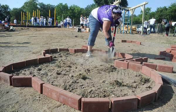 Globe/Roger Nomer<br /> Nikkole Test, Kansas City, Mo., digs a butterfly-shaped garden at the North Joplin Headstart on Saturday morning.
