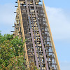 Globe/T. Rob Brown<br /> A construction worker with Rocky Mountain Construction Group of Idaho walks across the highest point of the Outlaw Run wood rollercoaster Thursday morning, Aug. 9, 2012, at Silver Dollar City. The new coaster is being touted as the first wood coaster to feature a double barrel roll in addition to its record-breaking 81-degree steep drop and a projected top speed of 68 miles per hour.