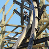 Globe/T. Rob Brown<br /> A construction worker with Rocky Mountain Construction Group of Idaho is framed by one of the inversion points of the Outlaw Run wood rollercoaster Thursday morning, Aug. 9, 2012, at Silver Dollar City. The new coaster is being touted as the first wood coaster to feature a double barrel roll in addition to its record-breaking 81-degree steep drop and a projected top speed of 68 miles per hour.
