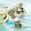 Globe/Roger Nomer<br /> Wilda Key, top, and Suzie Hinkle line up along a wall for leg exercises during a fitness class at Walton Park pool in Nevada on Tuesday.