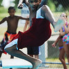 "Globe/T. Rob Brown<br /> D.J. Kress, 12, of Joplin, leaps off the diving board in what he calls, ""Kung Fu Style,"" at Schifferdecker Park Pool Thursday afternoon, Aug. 2, 2012."